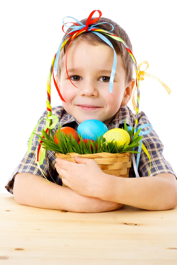 Smiling Boy With Easter Eggs In Basket Royalty Free Stock Photography
