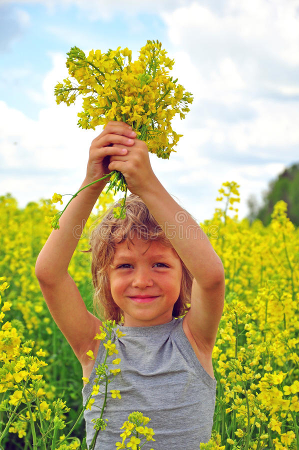 Download Smiling boy with flowers stock photo. Image of countryside - 40577638