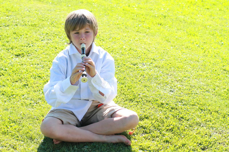 Download Smiling boy with a flute stock image. Image of water - 25306209