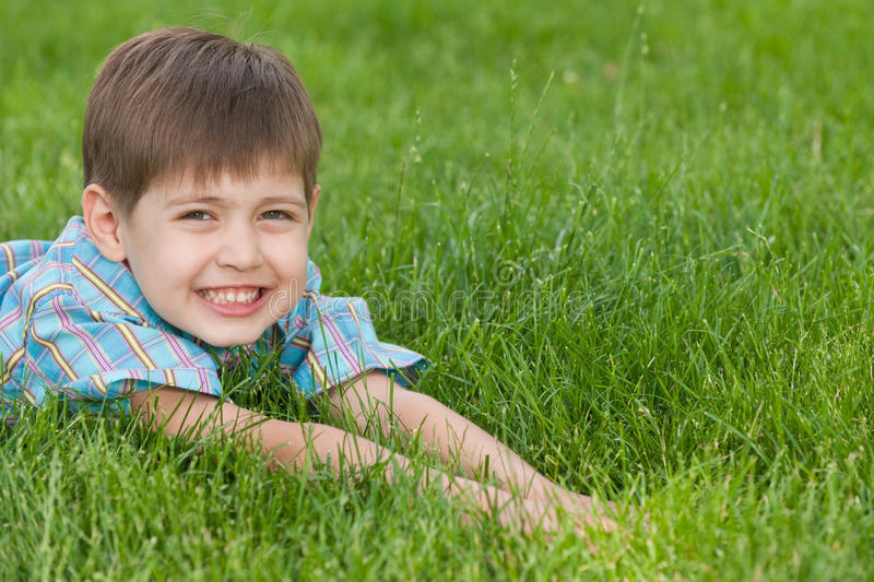 Download Smiling Boy On The Green Lawn Stock Image - Image: 19861199