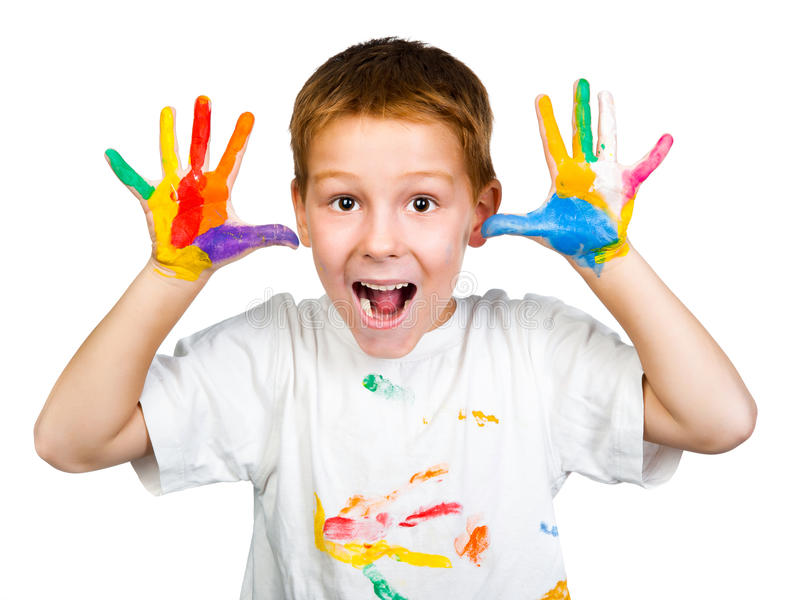 Smiling boy with hands in paint stock image