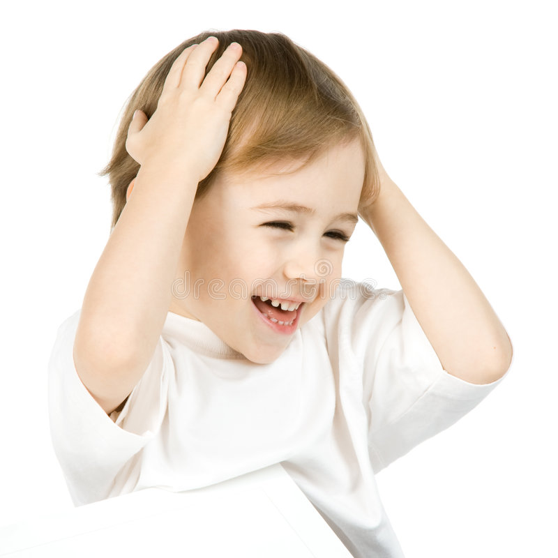 Smiling boy holding head stock photos