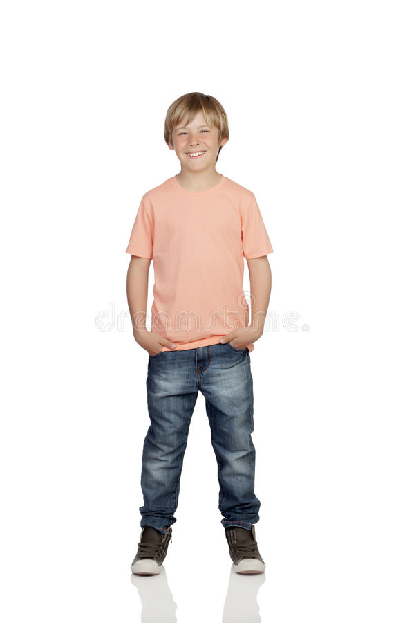 Smiling boy with jeans standing. Isolated on white background stock image