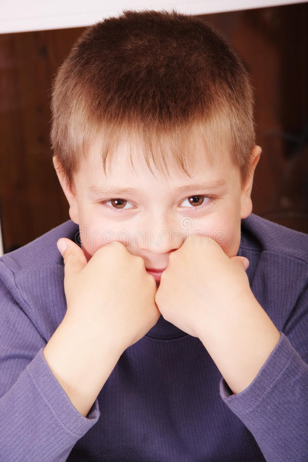 Download Smiling Boy Leaning On Fists Stock Photo - Image: 12077270