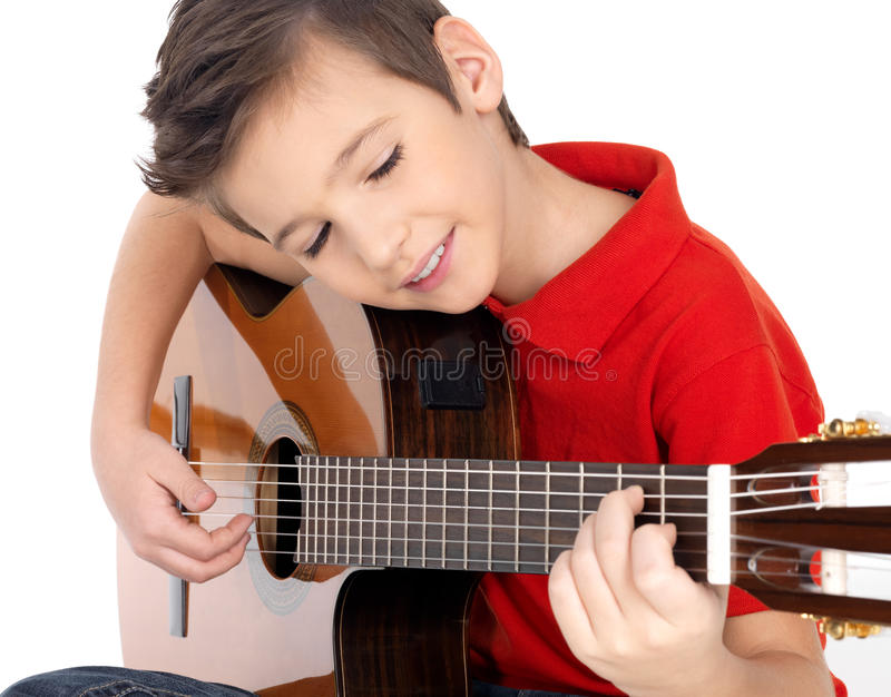 Smiling boy is playing the acoustic guitar stock photos