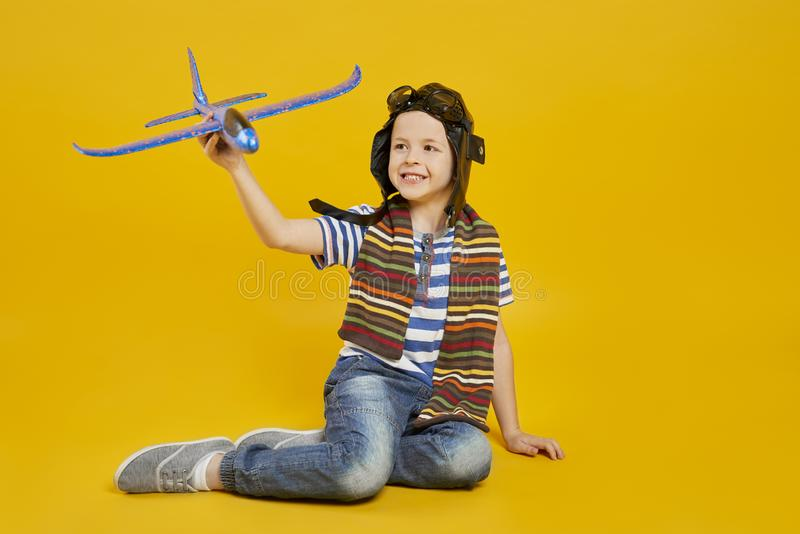 Child playing with toy plane stock photography