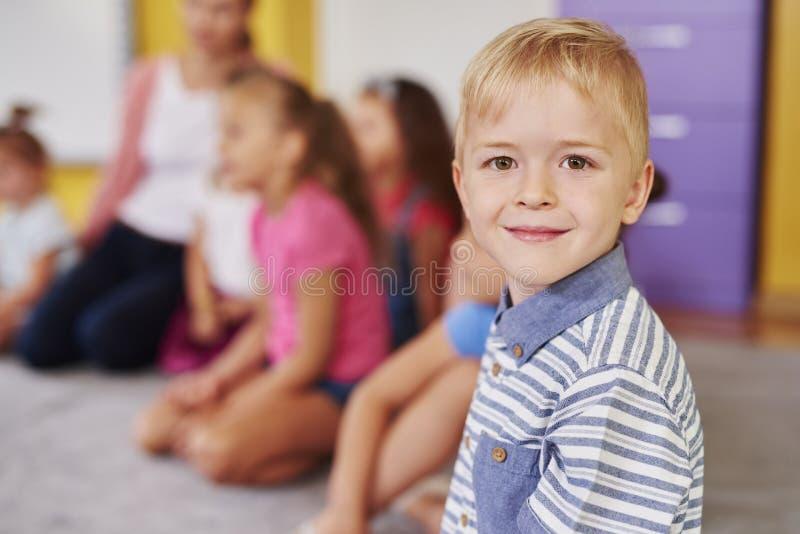 Smiling boy in the preschool stock photo
