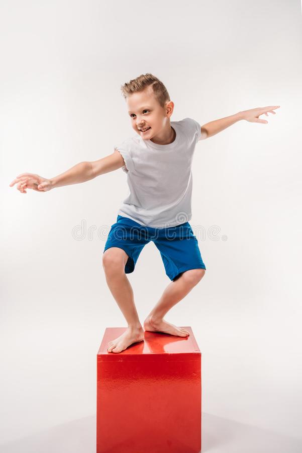 smiling boy pretending to be a surfer, stock photos