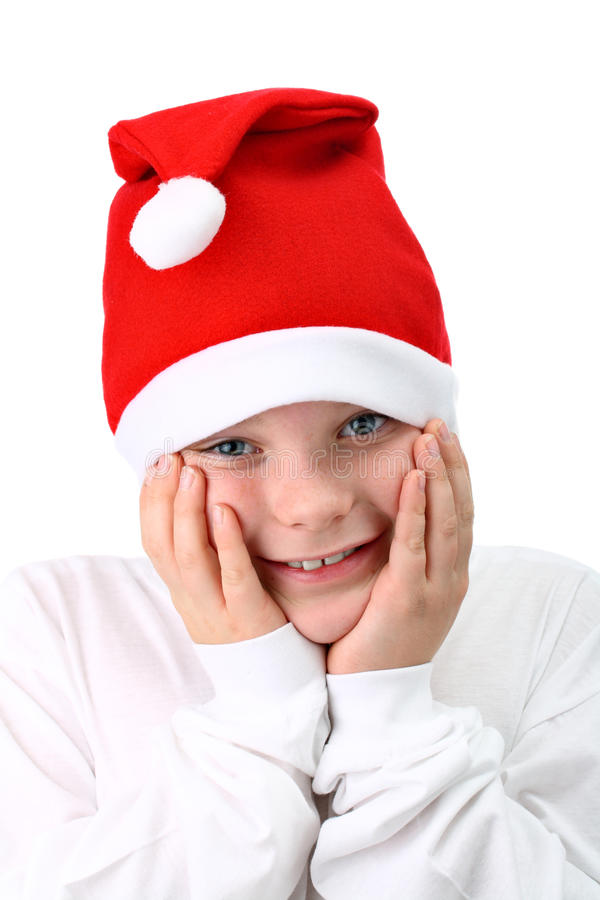 Smiling Boy In Santa S Red Hat Isolated On White Stock Photography