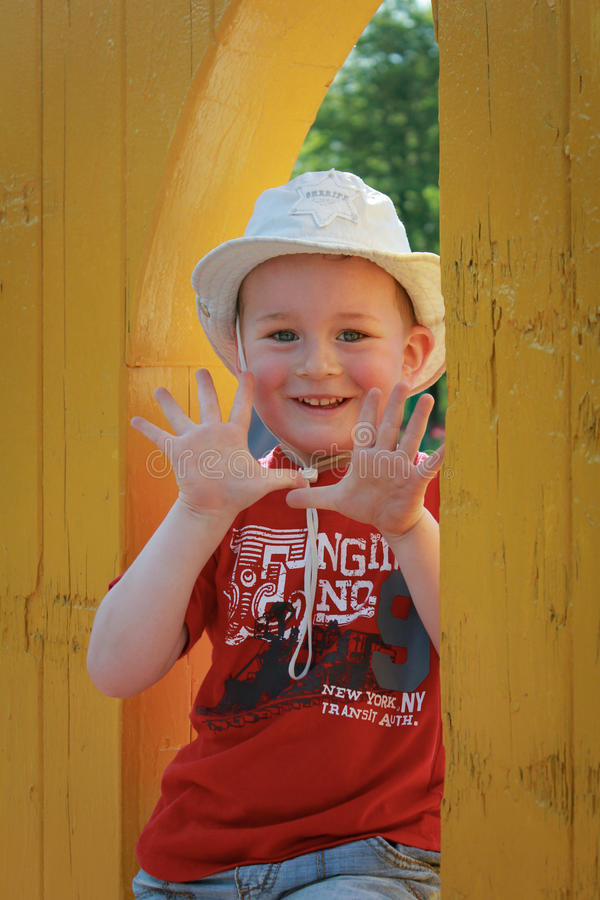 Smiling boy. Showing his hands stock photo