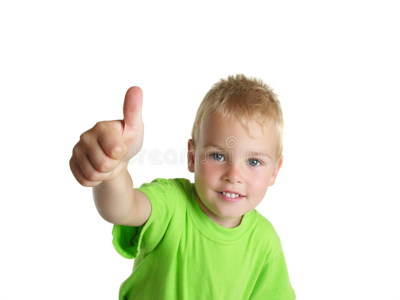 Smiling boy shows ok gesture isolated on white royalty free stock photography