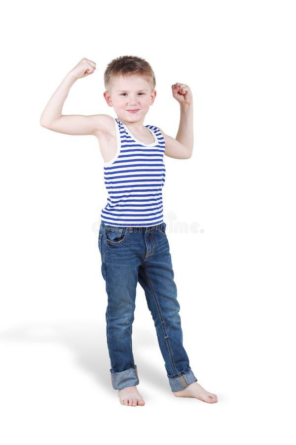 Smiling boy strains biceps
