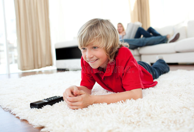 Download Smiling Boy Watching Football Match Stock Photos - Image: 12724993