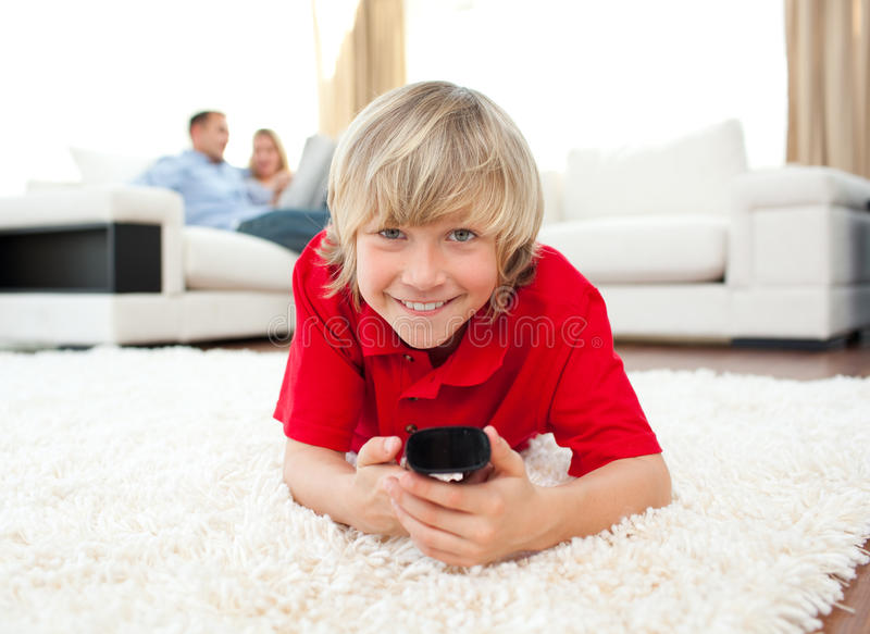 Download Smiling Boy Watching TV Lying On The Floor Stock Image - Image: 12724981