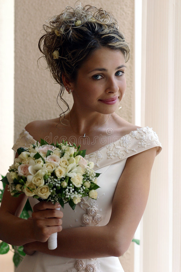 Smiling bride with bouquet royalty free stock photos