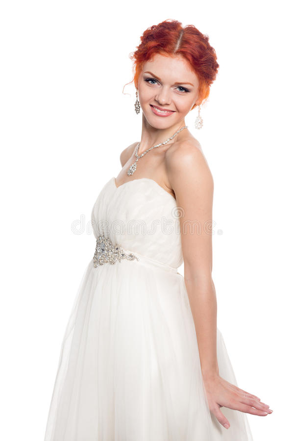 Smiling bride in a gala dress stock photo