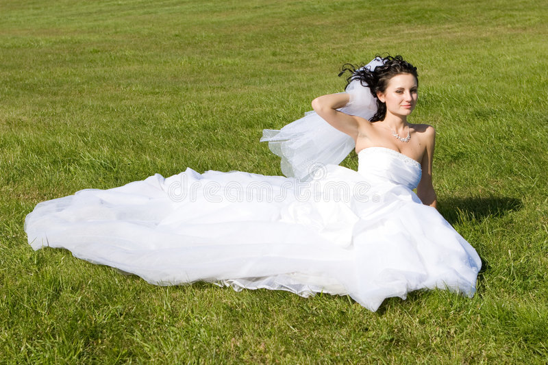 Smiling bride on the grass stock photos