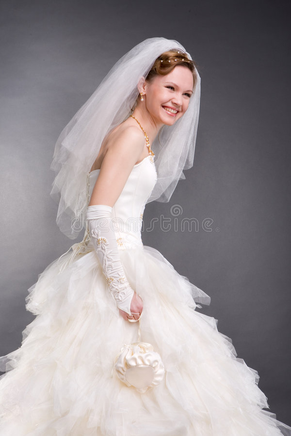 Smiling bride in the studio stock photography