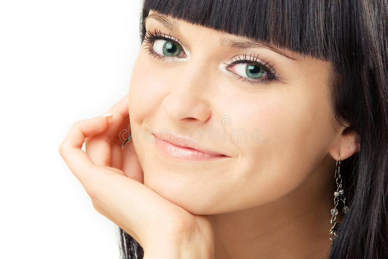 Smiling brunette. Close up portrait of young smiling brunette stock image