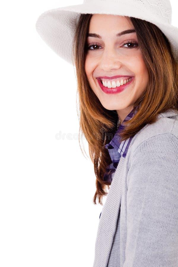Smiling brunette model side pose stock photography