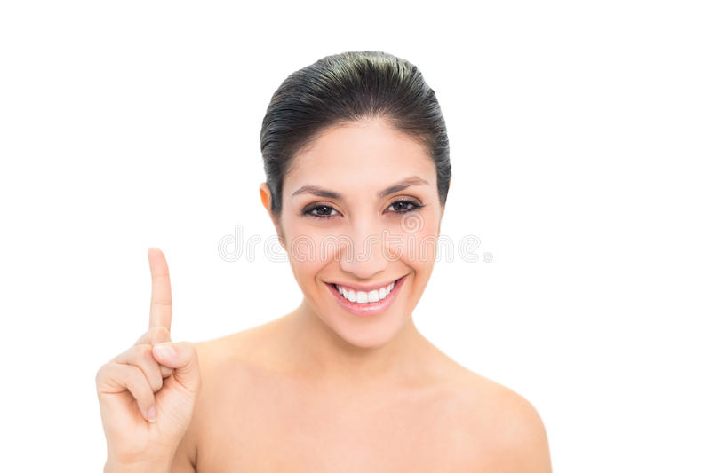 Download Smiling Brunette Pointing Up With One Hand Stock Photo - Image: 33050322
