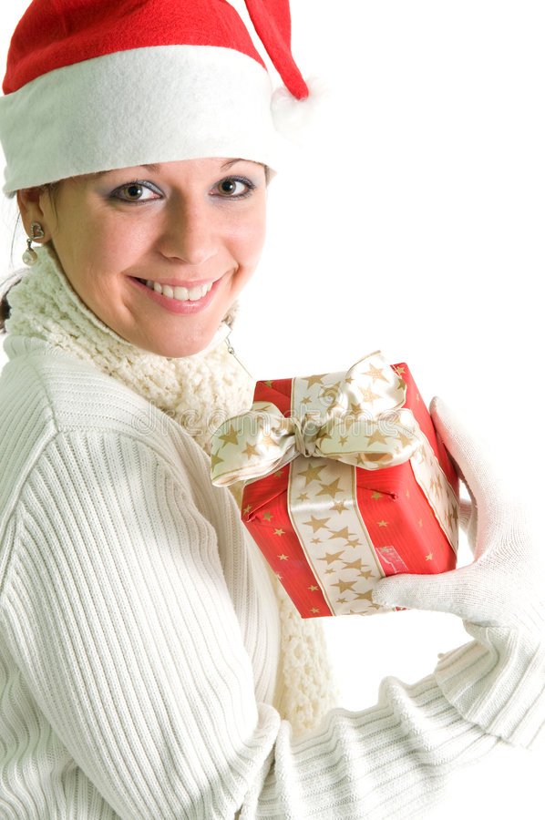 Smiling brunette with present. Smiling brunette showing present, isolated over white royalty free stock photo
