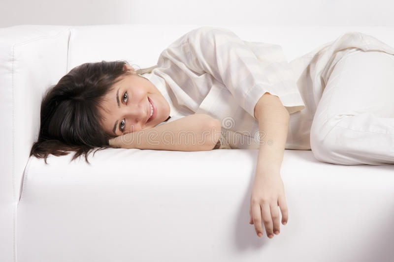Smiling Brunette On Sofa Royalty Free Stock Images