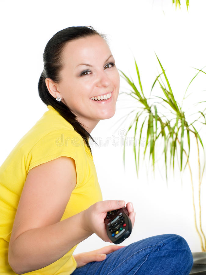 Smiling Brunette Woman Watching Tv Stock Image