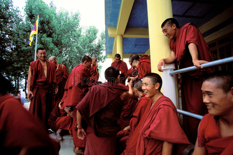 Smiling Buddhists waiting to see the Dalai Lama in India stock photography