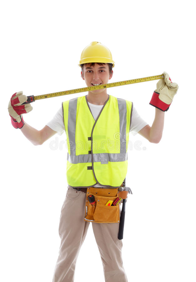 Smiling builder or carpenter. Apprentice or student carpenter or builder smiling, with tools and measuring tape. White background royalty free stock photos