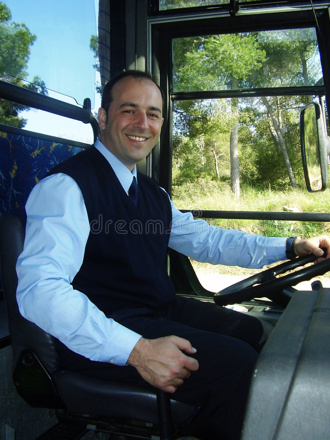 Smiling Bus Driver. Vivid shot of smiling bus driver in daytime stock images