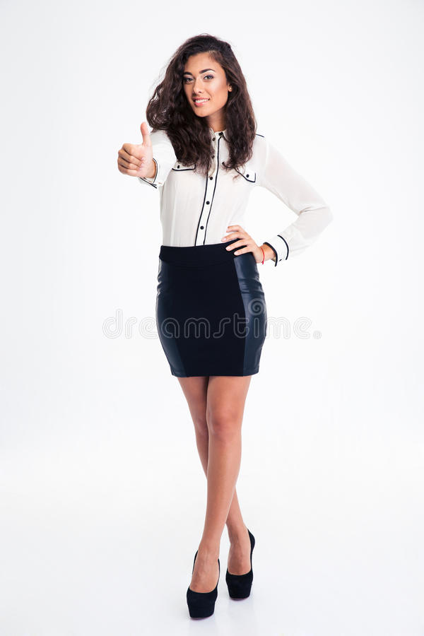 Smiling busiensswoman showing thumb up. Full length portrait of a smiling beautiful busiensswoman showing thumb up isolated on a white background. Looking at stock photography