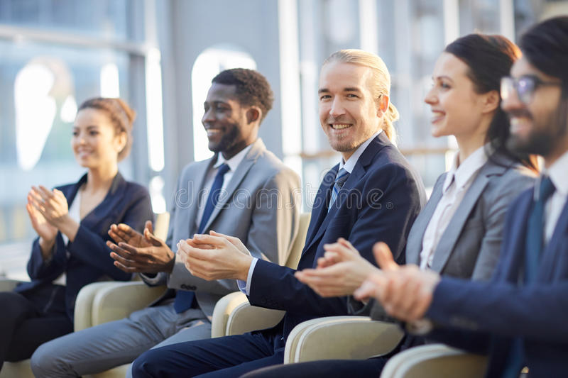 Smiling Business Audience Clapping stock photography