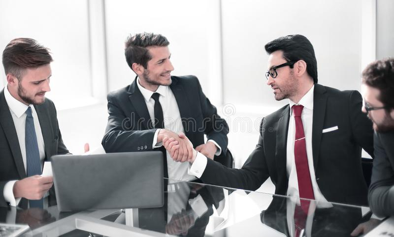 Smiling business colleagues shaking hands with each other. royalty free stock images