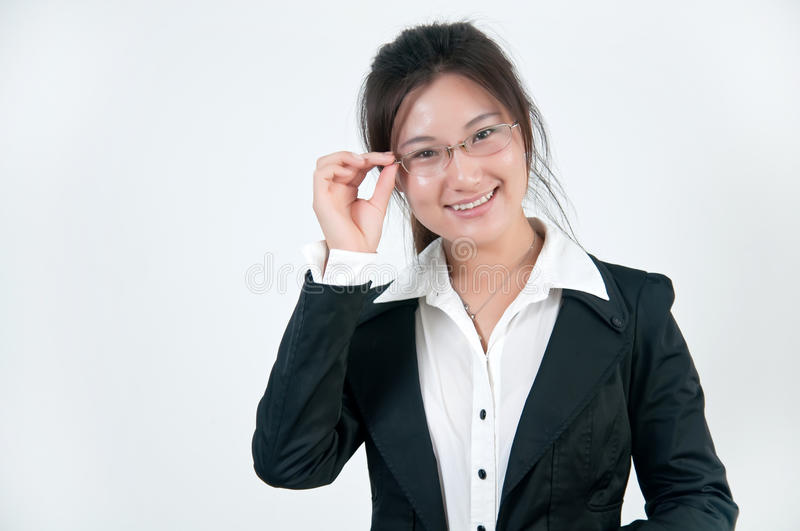 A Smiling business girl in glasses royalty free stock photo