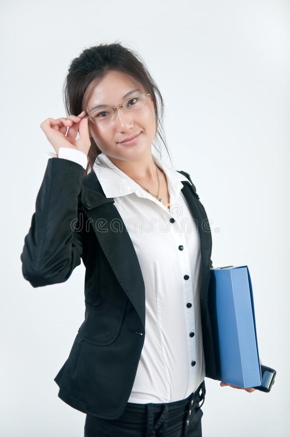 A Smiling business girl in glasses royalty free stock image