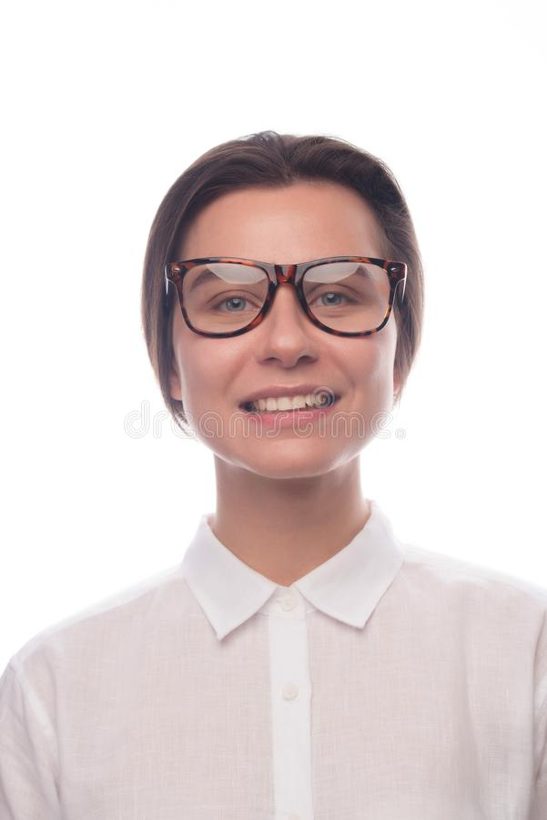 Smiling business girl with glasses. Studio portrait royalty free stock image