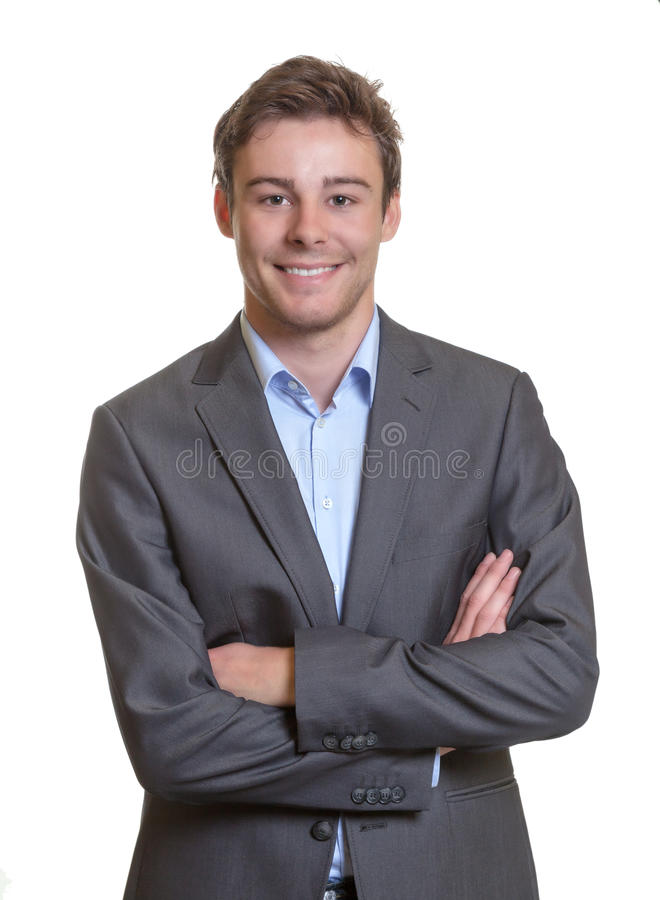 Smiling business man with crossed arms royalty free stock photos