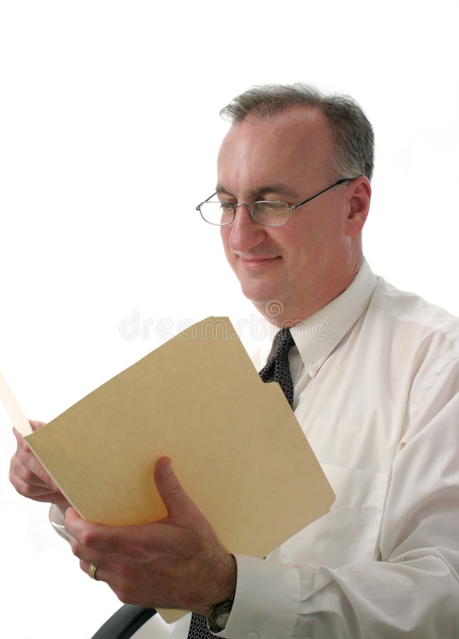 Smiling business man reading report ver2 stock photo