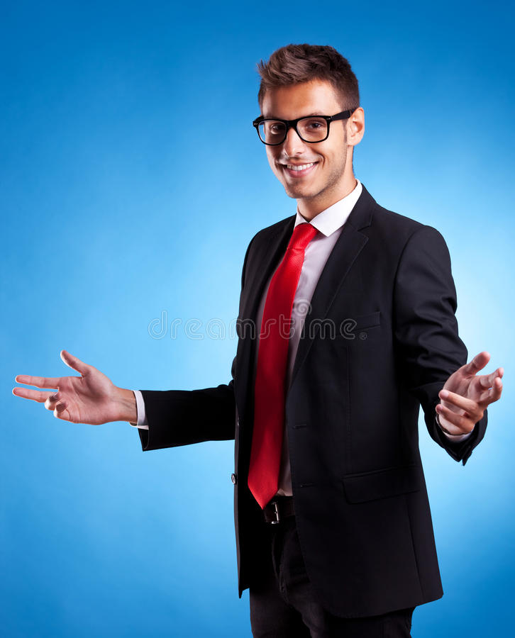 Smiling business man welcoming