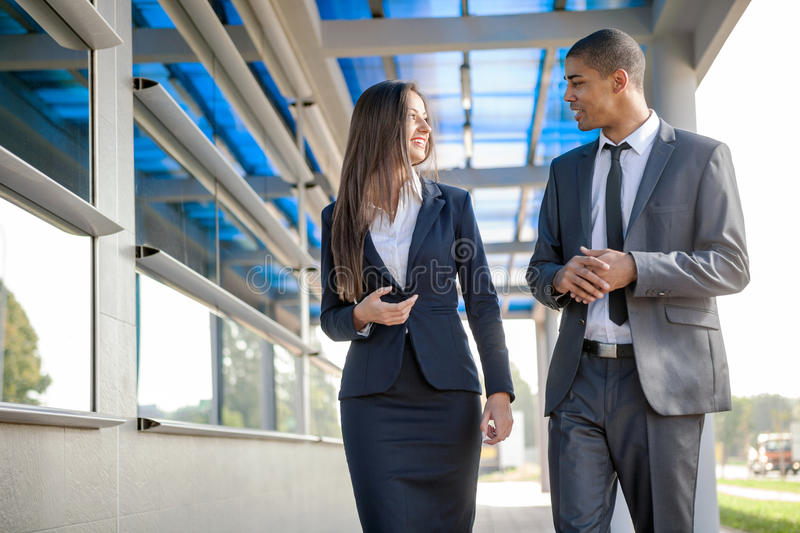 Smiling business man and woman on break ,walking around and talk stock photo