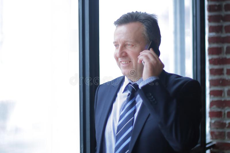 Smiling business men talking on the phone. Photo with copy space stock images