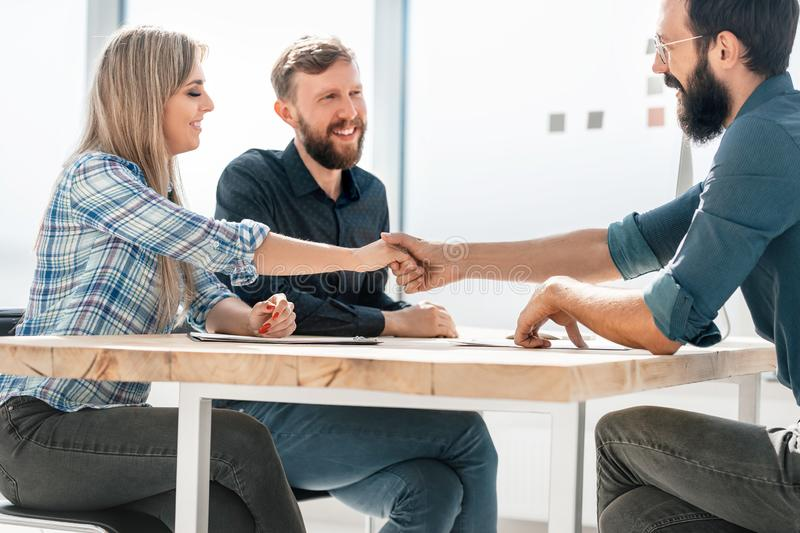 Smiling business partners handshake during a business meeting. Concept of partnership stock photography