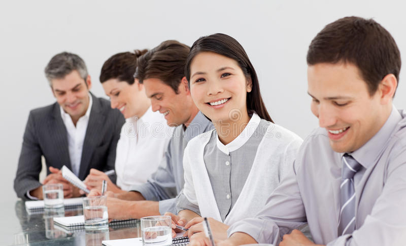 Smiling Business Partners Taking Notes Stock Photo