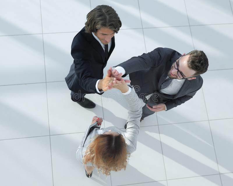 Business people giving high five staying in the office royalty free stock photos