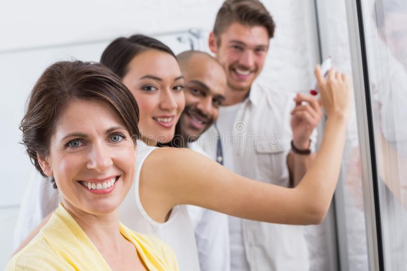 Smiling business people looking at camera during a meeting royalty free stock photography