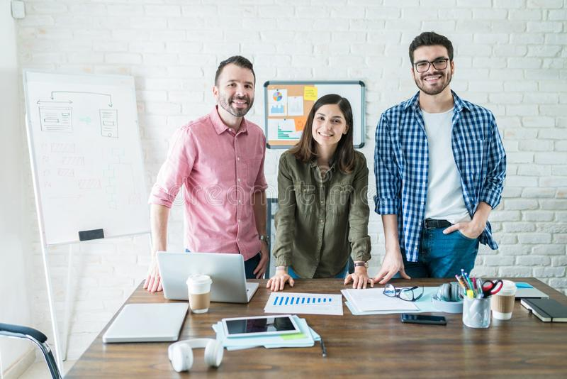 Smiling Business Team In Conference Room At Office stock photography