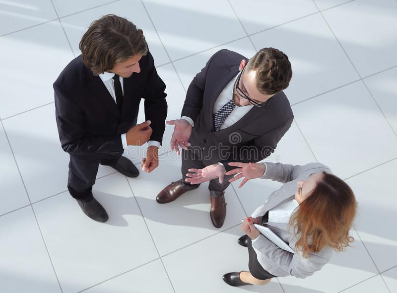 Group of coworkers discussing in conference room stock images