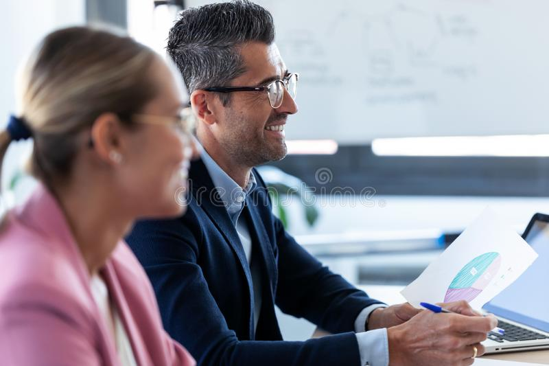 Smiling business team listening her partners on coworking space stock images