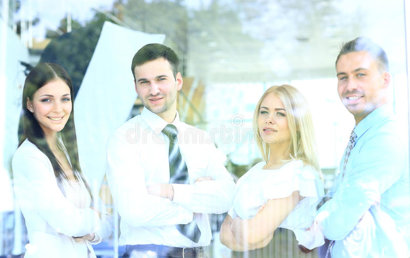 smiling business team looking through window
